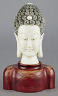 Asian:Chinese, A CHINESE CARVED IVORY AND ENAMEL HEAD OF BUDDHA ON CARVED WOODENBASE . 20th century . 11-5/8 inches high (29.5 cm) (includ...