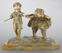 A FRENCH PATINATED GILT BRONZE AND IVORY FIGURAL GROUPING BY DEMETRE CHIPARUS (ROMANIAN, 1886-1947) Circa 1920