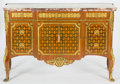 Furniture : French, A LOUIS XVI STYLE INLAID KINGWOOD COMMODE WITH GILT BRONZE MOUNTS .Circa 1900. 34-3/4 x 46 x 24 inches (88.3 x 116.8 x 61.0...