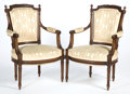 Furniture : French, A PAIR OF LOUIS-PHILIPPE CARVED WOOD ARM CHAIRS . Circa 1850.35-1/8 x 23 x 20 inches (89.2 x 58.4 x 50.8 cm). ... (Total: 2Items)