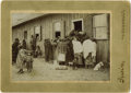 Photography:Cabinet Photos, IRWIN CABINET CARD - DRAWING RATIONS. This interesting scenedepicts a group of Indian women crowded around the door of a wo...(Total: 1 Item)