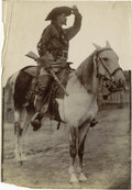 """Photography:Official Photos, BUFFALO BILL SCANS THE HORIZON. Large (6½"""" x 9½"""") sepia-toned photoof Buffalo Bill Cody standing in the saddle, one hand ra... (Total:1 Item)"""