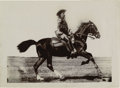 "Photography:Official Photos, BUFFALO BILL ON HORSEBACK BY UNKNOWN PHOTOGRAPHER. This 7½"" x 5½""image of Cody riding a black horse with white socks was mo...(Total: 1 Item)"