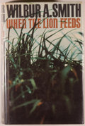 Books:Fiction, Wilbur A. Smith. When the Lion Feeds. London: Heinemann,1964. First edition. Octavo. 459 pages. Publisher's clo...