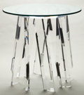 Furniture , A LUCITE AND GLASS MULTI-LEG TABLE . Late 20th century . 29 inches high x 30 inches diameter (73.7 x 76.2 cm). ...