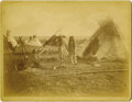"Photography:Cabinet Photos, INDIAN ENCAMPMENT BY UNKNOWN PHOTOGRAPHER. This 9"" x 7"" sepia imageby an unknown photographer depicts an Indian encampment ... (Total:1 Item)"