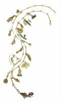 Estate Jewelry:Necklaces, Enamel, Gold, Silver Charm Necklace. The 14k yellow gold necklacefeatures fifteen eclectic charms depicting images from a...