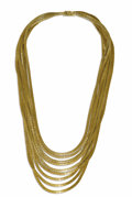 Estate Jewelry:Necklaces, Gold Necklace. The spaghetti style necklace is composed of ninegraduated strands of Florentine finished 18k yellow gold. ...
