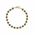 Estate Jewelry:Necklaces, Black Onyx, Gold Necklace. The necklace features black onyxrondelles measuring approximately 12.00 x 4.00 mm, flanked by ...