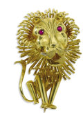 Estate Jewelry:Brooches - Pins, Ruby, Gold Brooch. The brooch in the form of a lion, peers out through round-cut ruby eyes, set in 18k yellow gold. Gross ...