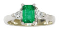 Estate Jewelry:Rings, Emerald, Diamond, White Gold Ring. The ring centers an emerald-cut emerald measuring 6.70 x 4.50 x 3.70 mm and weighing ap...