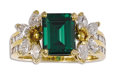 Estate Jewelry:Rings, Green Tourmaline, Diamond, Gold Ring. The ring centers an emerald-cut green tourmaline measuring 9.00 x 7.00 x 4.55 mm and...