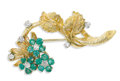 Estate Jewelry:Brooches - Pins, Diamond, Emerald, Gold Brooch. The floral design brooch featuresround-cut emeralds measuring 2.70 mm and weighing a total...