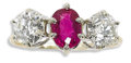 Estate Jewelry:Rings, Ruby, Diamond, Platinum, Gold Ring. The three-stone ring centers anoval-shaped ruby weighing approximately 1.25 carats, f...