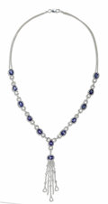 Estate Jewelry:Pendants and Lockets, Sapphire, Diamond, White Gold Necklace. The Y-style necklacefeatures oval and pear-shaped sapphires weighing a total of a...