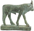African, An Egyptian Bronze Figure of the Apis Bull. . Egyptian. 26th/30thDynasty, Circa 664-331 B.C.. Bronze. 3.6 inches high x 4.4...