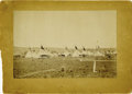 Photography:Official Photos, CROW AGENCY ENCAMPMENT, 1900. Sepia image of a large Crow encampment in Montana at the turn of the century. Photo reveals ap... (Total: 1 Item)