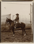 Photography:Official Photos, BUFFALO BILL AND STEED. Wonderful photograph of William F. Cody atop his stunning mount, as he prepares to enter the show ri... (Total: 1 Item)