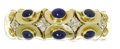 Estate Jewelry:Bracelets, Sapphire, Diamond, Gold Bracelet. The flexible cuff braceletfeatures oval-shaped sapphire cabochons ranging in size from ...