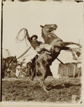 Photography:Official Photos, WILD WEST SHOW ACTION SHOT. Unknown Wild West Show performer holdsaloft a coiled rope as his horse rears up on his hind fee...(Total: 1 Item)