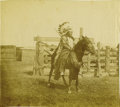 """Photography:Official Photos, PLAINS CHIEF WITH GREAT HEADDRESS. Sepia image measuring 4½"""" x 4"""" This Plains Native American Indian is wearing a long feath... (Total: 1 Item)"""