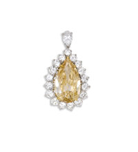 Colored Diamond, Diamond, Platinum Pendant  The pendant centers a pear-shaped champagne colored diamond measuring 20.00...