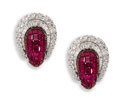 Estate Jewelry:Earrings, Ruby, Diamond, Platinum Earrings. The horseshoe motif earringsfeature baguette and full-cut diamonds encircling a domed r...