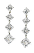 "Estate Jewelry:Earrings, Diamond, Platinum Earrings. Each ""Journey"" earring features fourgraduated square emerald-cut diamonds, set in platinum. ... (Total:1 Sets)"