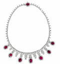 Estate Jewelry:Necklaces, Ruby, Diamond, Platinum Necklace. The fringed necklace is highlighted by oval-shaped rubies ranging in size from 9.00 x 7....