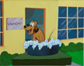 Animation Art:Production Cel, Pluto Production Cel Set-Up with Background Animation Art(Disney, 1940s)....