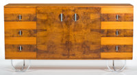 A GILBERT ROHDE WALNUT AND BURL WALNUT BUFFET FOR HERMAN MILLER Designed by Gilbert Rohde (American, 1894-1944)