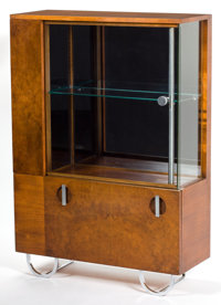 A GILBERT ROHDE BURL WALNUT AND GLASS CHINA CABINET FOR HERMAN MILLER Designed by Gilbert Rohde (American, 1894-1