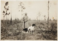 Photography:Cabinet Photos, Annie Oakley: An Original Photo on a Shooting Excursion with Beloved Dog Dave, Inscribed on Verso by Frank. ...
