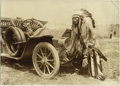 Photography:Cabinet Photos, RARE WILD WEST SHOW NATIVE AMERICAN INDIAN WITH FULL REGALIA ANDHEADDRESS. FROM HORSE TO AUTOMOBILE - circa 1915.. The Nati...(Total: 1 Item)
