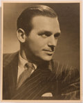 Autographs:Celebrities, Douglas Fairbanks Jr. Signed Reproduction Still by George Hurrell.Measures 8 x 10 inches. Boldly signed by Fairbanks. F...