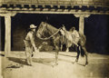 "Western Expansion:Cowboy, COWBOY CLEANS HIS HORSE'S SHOES - ca. 1890. This is a niceun-mounted silver-nitrate print that measures 6.5""x 4.5"" andfeat... (Total: 1 Item)"