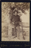 Photography:Cabinet Photos, ARMED FORT NIOBRARA, NEB. SOLDIER WITH RIFLE, PISTOLS AND BOWIEKNIFE - CABINET CARD ca. 1890-95. This soldier is identified...(Total: 1 Item)
