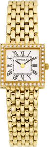 Estate Jewelry:Watches, Tiffany & Co. Lady's Diamond, Gold Integral BraceletWristwatch, modern. ...