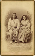 Photography:Cabinet Photos, ZE-LE & WIFE TZES-TON CHIRICAHUA APACHES ca. 1880'S. Very nicestudio photograph of two Chiricahua Apaches. Apache man is h...(Total: 1 Item)