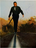 Music Memorabilia:Autographs and Signed Items, A Johnny Cash Signed Promotional Image....