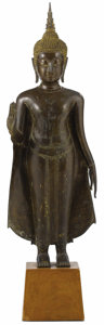 Asian:Other, An Ayuthya Bronze Standing Buddha. Unknown maker. Southeast Asia.15th/16th century. Bronze. 25.5 inches high. The statu...
