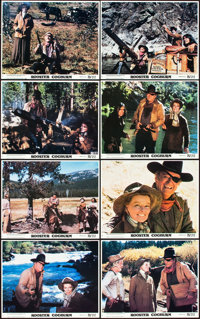 "John Wayne Lot (Various, 1957-1976). Mini Lobby Card Sets of 8 (3) (8"" X 10"") and a Color Photo set of 12 (8&q..."