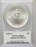 Modern Issues, 1986-P $1 Statue of Liberty Silver Dollar, Insert autographed byJohn M. Mercanti, 12th Chief Engraver of the U.S. Mint, MS69...