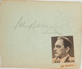 Autographs:Celebrities, John Barrymore (American Actor, 1882-1842). Clipped signature. [N.p., n.d.]. Pencil signature on plain blue paper. With a ne...