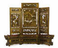 Asian:Chinese, An Asian Three-Panel Screen. Unknown maker, Asian. 19th century.Lacquer and gilt wood. Unmarked. 33 inches high. The th...