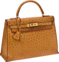Luxury Accessories:Bags, Hermes 32cm Cognac Ostrich Rigide Kelly Bag with Gold Hardware. ...(Total: 2 Items)