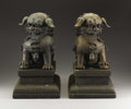 Bronze, A Fine Pair of Chinese Bronze Figures of Buddhist Lions on Stands. . China. 19th Century. Bronze. 13 inches high (each lion)... (Total: 2 Items)