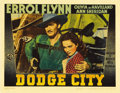 "Movie Posters:Western, Dodge City (Warner Brothers, 1938). Lobby Card (11"" X 14""). Errol Flynn takes his Australian accent to the Old West and it w..."