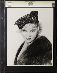 "Goin' to Town - Culver Pictures (Paramount, 1935). Still (10"" X 13""). Mae West presents the camera with her sm..."