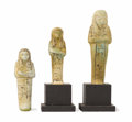 Sculpture, Three Blue-Green Faience Ushabtis. Unknown maker, Egyptian. New Kingdom (1554-1080 BC). Carved faience. Unmarked. The tall... (Total: 4 Items)